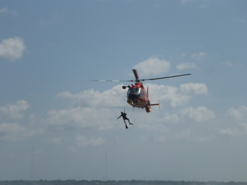 Lowering rescue swimmer
